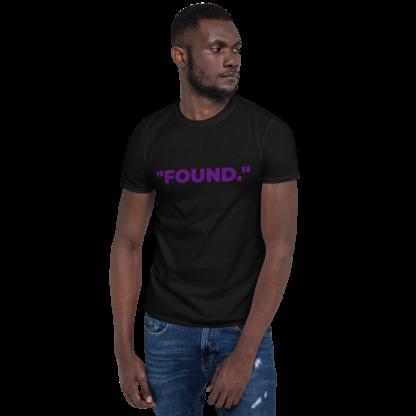 Black man wearing 'FOUND' Black T-Shirt