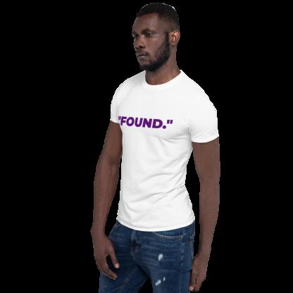 Black man wearing 'FOUND' White T-Shirt